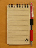 Paper notebook and pen Royalty Free Stock Images