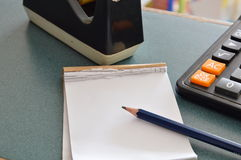 Paper notebook and pencil on table Royalty Free Stock Image