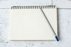 Paper notebook and pencil on white wood Stock Photography