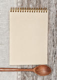 Paper notebook, wooden spoon and linen fabric on the old wood Stock Photo