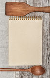 Paper notebook, wooden utensils and linen fabric on the old wood Royalty Free Stock Photos