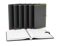 Paper notebooks. One open paper notebook and a row of closed paper notebooks on white background (3d render Stock Images