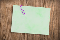 Paper noteon old table, clipping path. Stock Images