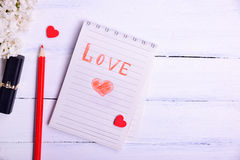 Paper notepad with an inscription love Royalty Free Stock Photos