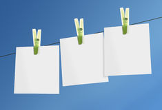 Paper notes. Blanek paper notes on line against blue sky Stock Images