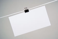 Paper for notes. Sheet of paper for notes hanging on rope Royalty Free Stock Photography