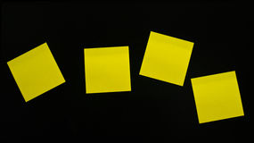 The paper notes on a black background. Royalty Free Stock Photography