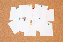 Paper notes on cork board Stock Photography