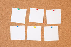Paper notes on cork board Royalty Free Stock Image