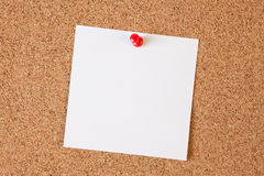 Paper notes on cork board Royalty Free Stock Images