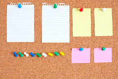 Paper notes on cork board Stock Photo