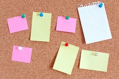 Paper notes on cork board Royalty Free Stock Photos