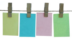 Paper notes hanging on rope. Colored big paper notes hanging on rope (isolated on white background Stock Photos