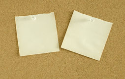 Paper notes pin on cork board. Two paper notes pin on cork board Stock Image