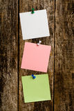 Paper notes in the wooden wall. Paper notes clipped on the shabbey wooden wall Stock Images