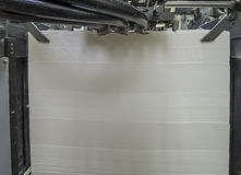 Paper in Offset Printing Machine. Stack of blank paper in a modern offset printing machine royalty free stock image