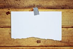 Paper on old wall Stock Photography