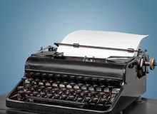 Old typewriter with paper on table background. Paper old write type writer typewriter white Royalty Free Stock Images