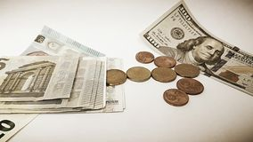 Paper one hundred US dollars and Euro trifle stock photos