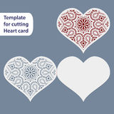 Paper openwork  wedding card, heart shape,  greeting postcard, template for cutting, lace imitation,  gift on Valentine's Day Stock Photography