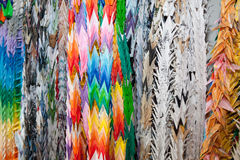Paper Oragami Cranes. Thousands of colorful origami cranes hanging in a temple in Tokyo, Japan Stock Photo