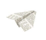 Paper origami airplane. Newspaper Handicraft Stock Image