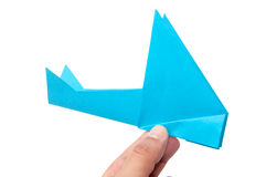 PAPER ORIGAMI AIRPLANE OVER WHITE BACKGROUND Stock Images