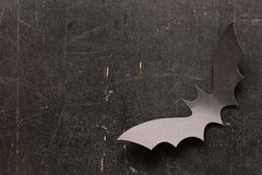 Paper origami bats on a wooden background, decorations for holiday Halloween Stock Image