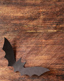 Paper origami bats on a wooden background, decorations for holiday Halloween Royalty Free Stock Photography