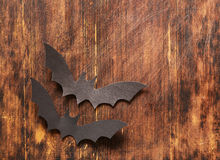 Paper origami bats on a wooden background, decorations for holiday Halloween Royalty Free Stock Photos