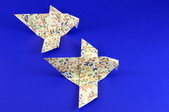 Paper origami birds on blue Stock Photo