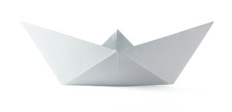 Paper origami boat. On the white background Stock Photo