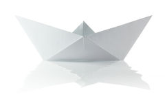 Paper origami boat. On the white background Stock Photos