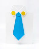 Paper origami clothes. Unique business greeting card folded as businessman clothes. Low view Royalty Free Stock Photography