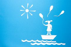 Paper origami girl in boat with balloons. Free state concept. Origami sun, sea waves, boat and girl on blue background. Peace in world stock illustration