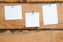 Paper over an old wood background Royalty Free Stock Photo