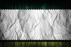 Paper over wooden background Royalty Free Stock Photography