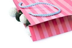 Paper package with candies. Pink paper package in a strip with candies Stock Photography
