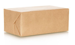 The paper package isolated on white. The craft paper package isolated on white royalty free stock photography