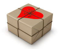 Paper package tied with string and heart. Stock Image
