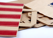 Paper packs with holders. Different paper grocery packs with holders Stock Photography