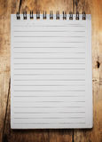Paper page notebook. Textured on the wood backgrounds stock images