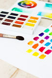 Paper, paint, brushes, color wheel. Workplace artist - paper, paint, brushes, color wheel Royalty Free Stock Photography