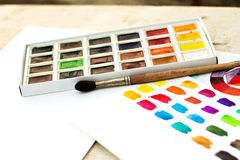- paper, paint, brushes, color. Workplace artist - paper, paint, brushes, color wheel Stock Image
