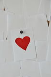 Paper paint red heart on noticeboard Royalty Free Stock Images