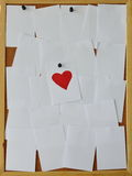 Paper paint red heart on noticeboard Stock Image