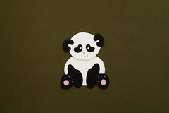 Paper panda applique. Cute little panda applique on texture background Stock Photo