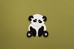 Paper panda applique. Cute little panda applique on texture background Royalty Free Stock Images