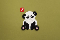 Paper panda applique. Cute little panda applique on texture background Stock Images