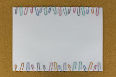 Paper with paper clip attached on the brown board Stock Images